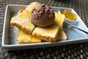 Ice-cream with bread and pineapple jam photo