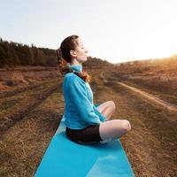 woman practicing yoga photo