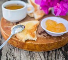 Toast with pineapple jam and tea. Breakfast Rustic photo