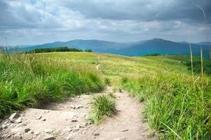 Hiking trail in mountains landscape