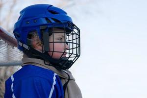 Boy plays hockey