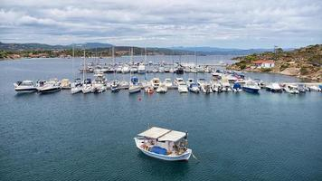 Aerial panoramic view of a marina with boats in Chalkidiki photo