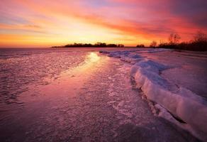 Winter landscape with sunset sky.