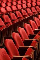 Three rows of red theater seats photo