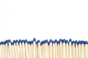 Matches in a row on white background photo