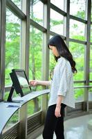 Girl stood to use computer monitor