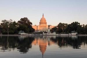 US Capitol illuminated by sunset sun
