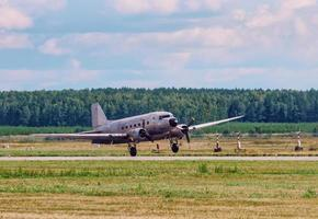 Douglas C 47 transport old plane boarded on runway photo
