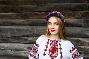 Young beautiful blonde girl with long hair in Ukrainian blouse
