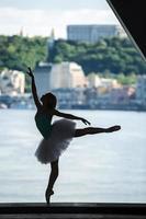 Silhouette of graceful ballerina in white tutu