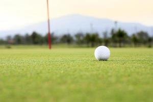 golf ball on green course photo