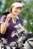 Smiling female golfer