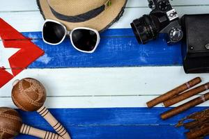 Cigars and vintage camera with maracas photo