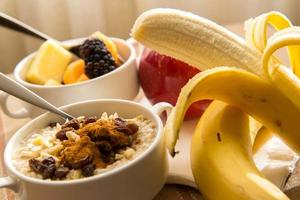 Fresh fruit and oatmeal with healthy toppings for breakfast