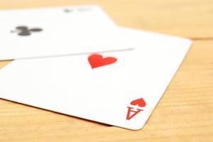 Poker cards on wood background photo