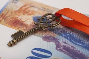 Key To Success With Red Bow on Swiss Franc note photo