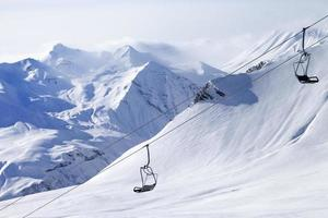 Chair lifts and off-piste slope in haze photo