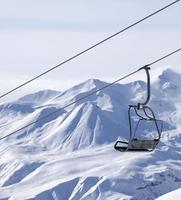 Chair lifts and off piste slope in fog