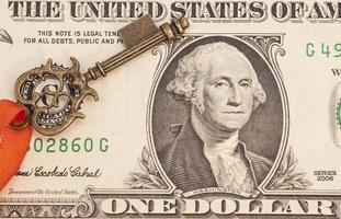 Key to success on one dollar banknote photo