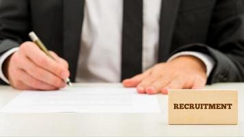 Applicant completing a job application photo