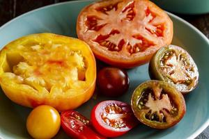 Assortment of Fresh Heirloom Tomatoes photo