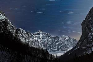 Star trails in the mountains photo