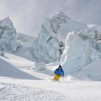 Skiing between seracs in Glacier - Stock Image