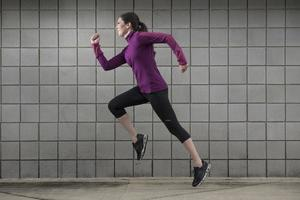 Young Woman Running for Fitness photo