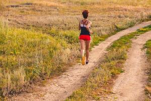 road beautiful healthy brunette young woman athlete running outd photo
