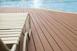 Close up of a deck chair sitting pool side