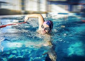 Young man swimming photo