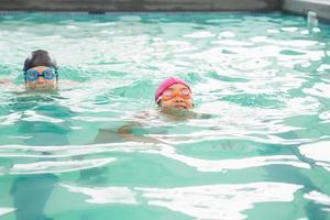 Cute swimming class in the pool