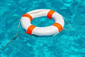 Life buoy in swimming pool photo