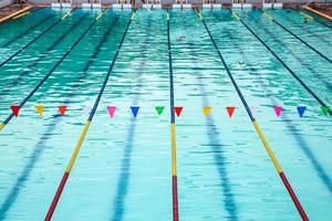 Swimming classes in an outdoor pool photo