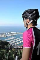 sportsman riding mountain bike photo