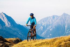Cyclist woman in hight mountais photo