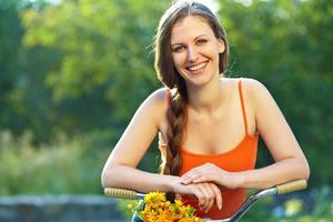 Young woman and bike photo