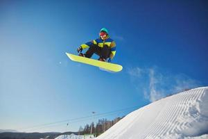 Snowboarding at resort photo