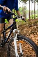 Girl riding bike on forest trails
