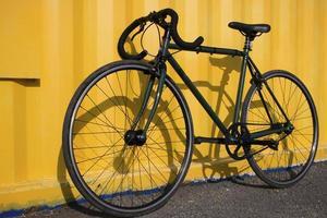 Green sport bike on a yellow background photo