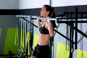 gym toes to bar woman pull-ups 2 bars workout