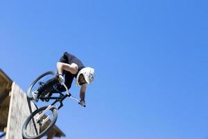 BMX biker down the ramp photo