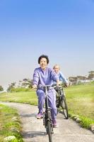 seniors couple biking in the park