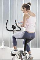 Woman using tablet computer in workout
