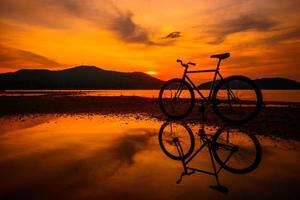 Silhouette bicycle with reflection photo