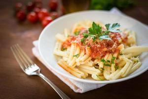Strozzapreti with tomato sauce photo