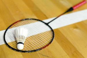 Shuttlecock on badminton racket photo