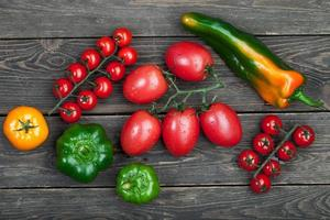Fresh tomatoes and peppers photo