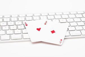 Poker cards on web keyboard photo