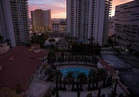 Buildings with a swimming pool in Las Vegas at dusk photo